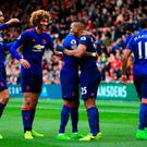 Manchester United's Luis Antonio Valencia (second right) celebrates scoring his side's third goal