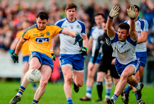 Ciarain Murtagh of Roscommon in action against Dessie Ward of Monaghan