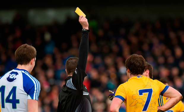 Referee Noel Mooney from Cavan giving David Murray of Roscommon a yellow card