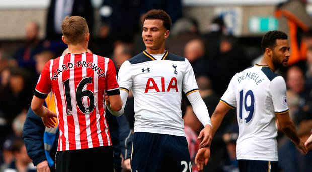 James Ward-Prowse of Southampton (L) and Dele Alli of Tottenham Hotspur (R) shake hands after the Premier League match between Tottenham Hotspur and Southampton at White Hart Lane. (Photo by Ian Walton/Getty Images)