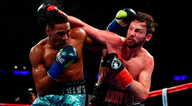 Andy Lee trades blows with KeAndrae Leatherwood during their middleweight bout at Madison Square Garden. Photo by Al Bello/Getty Images