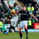 Moussa Dembele of Celtic in action with Dundee's Darren O'Dea. Photo: Reuters / Russell Cheyne