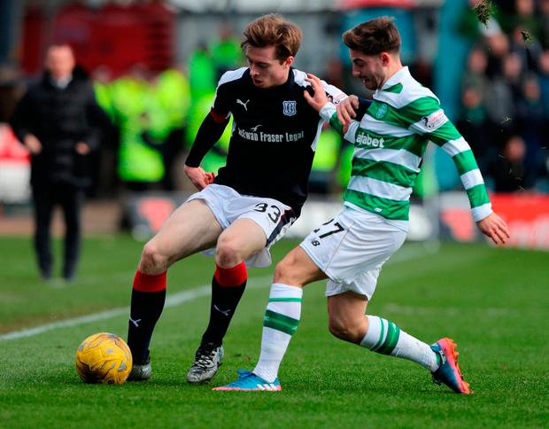 Celtic's Patrick Roberts (right) and Dundee's Craig Wighton battle for the ball. Photo credit: Andrew Milligan/PA Wire