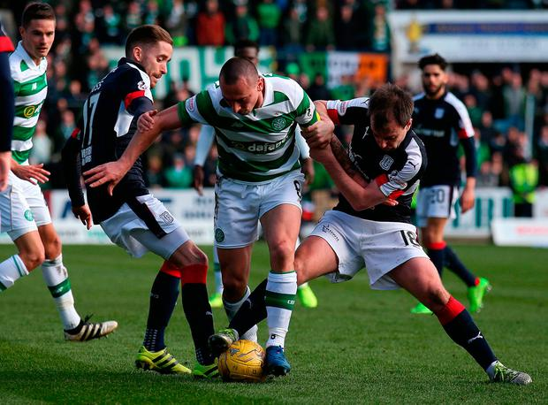 Celtic's Scott Brown and Dundee's Paul McGowan (right) in action. Photo credit: Andrew Milligan/PA Wire