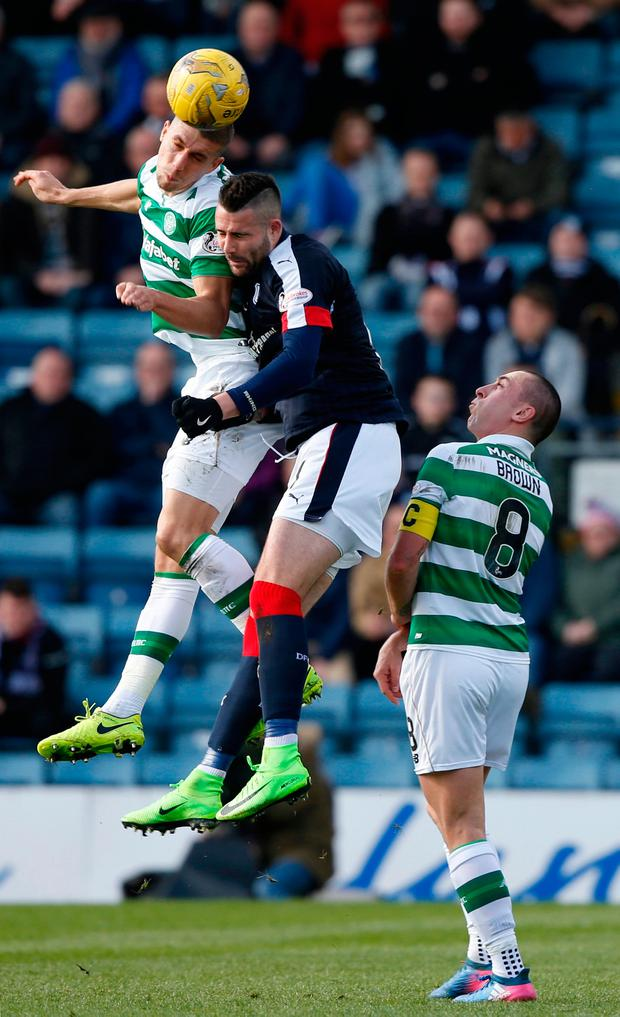 Celtic's Jozo Simunovic in action with Dundee's Marcus Haber. Photo: Reuters / Russell Cheyne