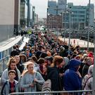 Crowds queue for GamerCon at the Convention Centre, Dublin. Photo: Douglas O'Connor