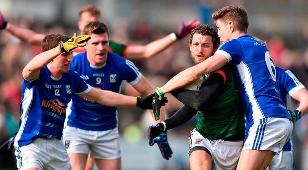 There's no way past for Tom Parsons of Mayo as he is crowded out by (from left) Cavan's Niall Clerkin, Tomás Corr and Killian Clarke. Photo: David Maher/Sportsfile