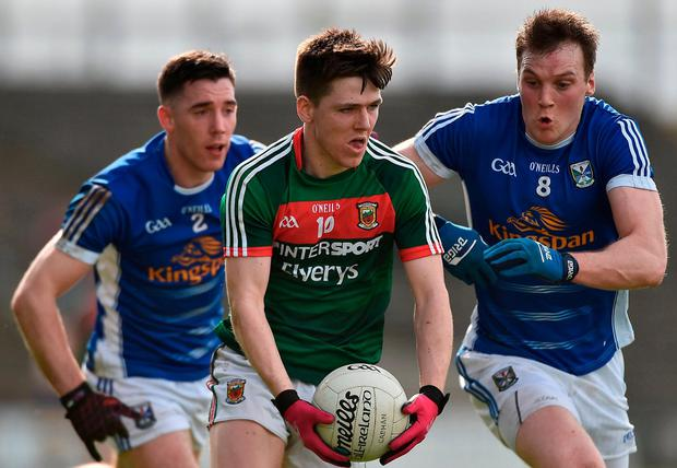 Mayo's Fergal Boland in action against Cavan's Geraoid McKiernan and Killian Brady. Photo: David Maher/Sportsfile