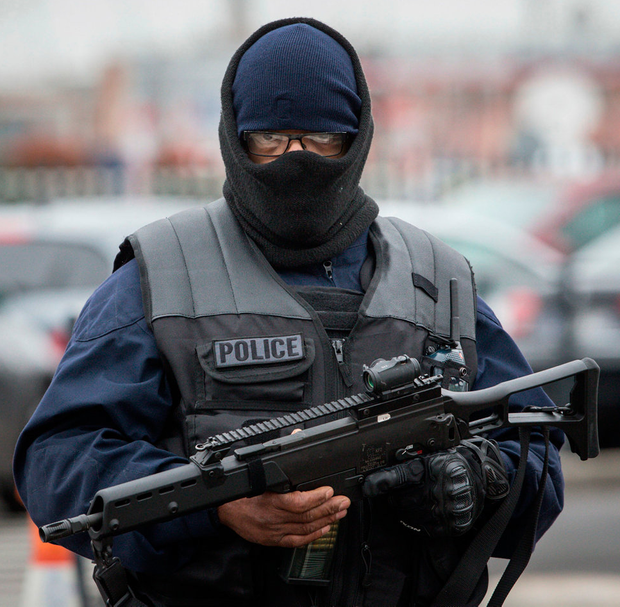 A policeman on patrol after the Orly Airport incident Photo: AP Photo/Kamil Zihnioglu