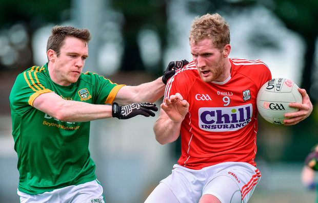 Ruairi Deane of Cork in action against Willie Carry of Meath. Photo by Matt Browne/Sportsfile