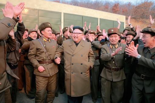 North Korean leader Kim Jong Un celebrates with his entourage after the test of a new high-thrust engine that could power a missile Photo: KCNA/via Reuters