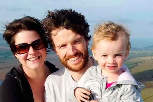Amy Dutil-Wall with her partner Vincent Wall, who is in hospital, and toddler Estlin, who lost her life.
