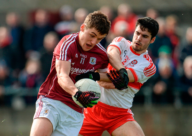 Michael Daly of Galway is fouled by Niall Keenan of Derry and a penalty is awarded. Photo by Sam Barnes/Sportsfile