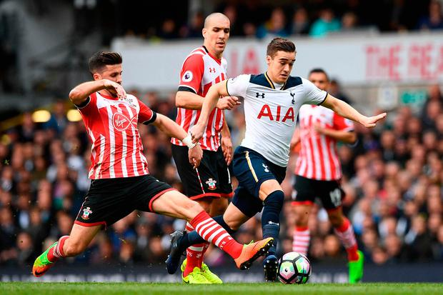 Southampton's Irish striker Shane Long (L) tackles Tottenham Hotspur's English midfielder Harry Winks. Photo: Getty Images