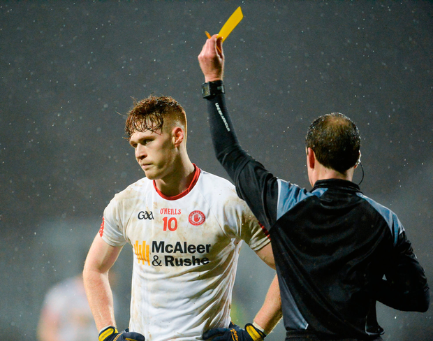 Conor Meyler of Tyrone receives a yellow card from Referee David Coldrick. Photo by Oliver McVeigh/Sportsfile