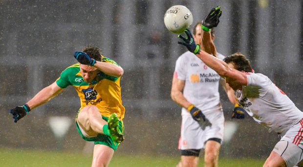 Martin O'Reilly of Donegal has his shot blocked down by Colm Cavanagh of Tyrone. Photo by Oliver McVeigh/Sportsfile