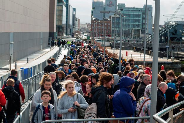 Queues build up outside the National Convention Centre