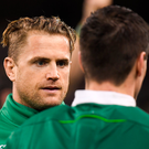Jamie Heaslip of Ireland speaks to Jonathan Sexton after the win against England