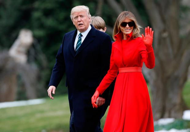 U.S. President Donald Trump and U.S. first lady Melania Trump walk with their son Barron to Marine One at the White House in Washington, U.S., March 17, 2017. REUTERS/Joshua Roberts