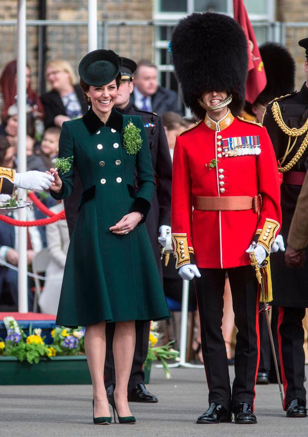 The Duchess of Cambridge hands out bunches of Shamrocks to soldiers of the 1st Battalion Irish Guards during their St Patrick's day Parade at Cavalry Barracks, Hounslow