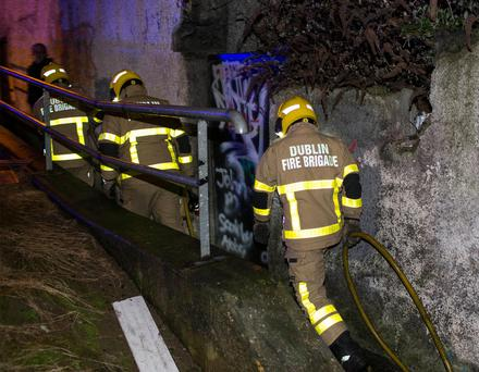 DFB fire fighters leave the scene of a fire of burning refuse near Emmet Road, Inchicore, Dublin.Photo: Conor O Mearain