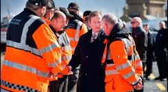 Taoiseach Enda Kenny chats with members of the Coast Guard during a visit to Blacksod in Co Mayo during the search and recovery of Rescue 116. Pic Steve Humphreys
