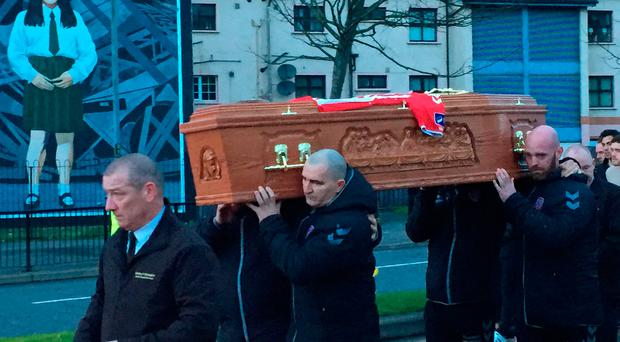 Ryan McBride's coffin is carried from a funeral house in the centre of Derry to his home in the Brandywell district of the city. Michael McHugh/PA Wire