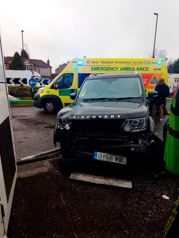 Undated West Midlands Ambulance Service handout photo of a 4x4 which was involved in a collision with a double-decker bus which then smashed into the side of a house in Coventry. Credit: Service/PA Wire
