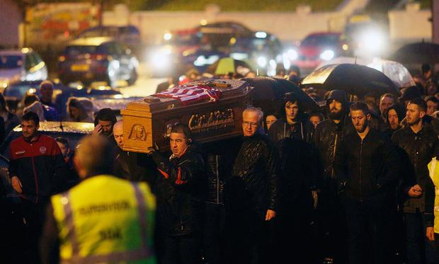 Ryan McBride's coffin is carried to the family home in Derry. Photo: Lorcan Doherty