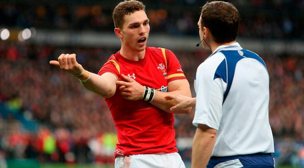 Wales' George North complains about an alleged bite during the game in the RBS 6 Nations match at the Stade de France.