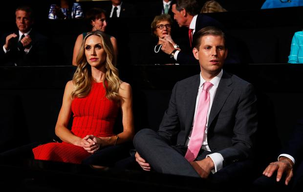 Eric Trump (R) along with his wife, Lara Yunaska, attend the third day of the Republican National Convention on July 20, 2016 at the Quicken Loans Arena in Cleveland, Ohio