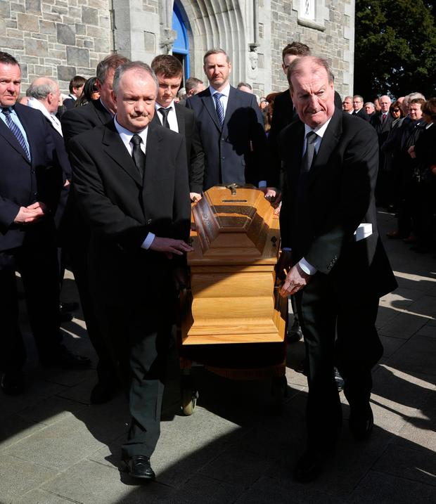 Maureen Haughey was      fiercely proud of and loyal to      her late     Independent Sean  left and Ciaran Haughey  stand by as the coffin enters St  Sylvester     s