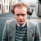 The late Martin McGuinness led the IRA on a remarkable journey from violence to politics over half a century, is pictured in Derry in 1985. Photo: Pacemaker Press