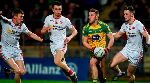 Tony McCleneghan of Donegal in action against Ben O'Donnell (L,) Paul donaghy, Cc) and Brian Kennedy of Tyrone. Donegal's tally of 14 wides the last day means they might have the biggest room for improvement. Photo: Philip Fitzpatrick/Sportsfile