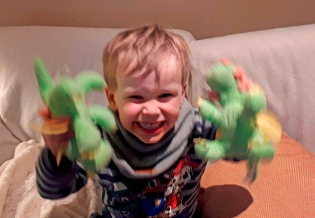 Mischievous Jamie Bracken-Murphy (3) got to keep two dragon toys after getting trapped in the arcade machine at the Jump 'n' Gyms play centre in Nenagh, Co Tipperary Picture: PA