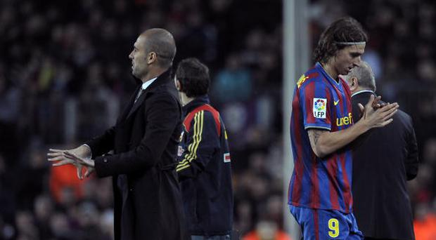 Barcelona´s coach Pep Guardiola (L) and Swedish forward Zlatan Ibrahimovic (R) react during their Spanish League football match against Getafe on February 6, 2010 at Camp Nou stadium in Barcelona. AFP PHOTO/LLUIS GENE (Photo credit should read LLUIS GENE/AFP/Getty Images)