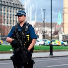 Police close to the Palace of Westminster, London, after policeman has been stabbed and his apparent attacker shot by officers in a major security incident at the Houses of Parliament. Victoria Jones/PA Wire