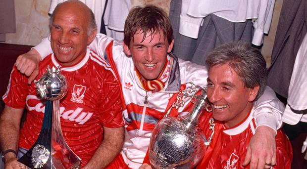 Ronnie Moran (left) celebrates with Kenny Dalglish and Roy Evans in 1990, Liverpool's last league title. Photo: Professional Sport/Popperfoto/Getty Images