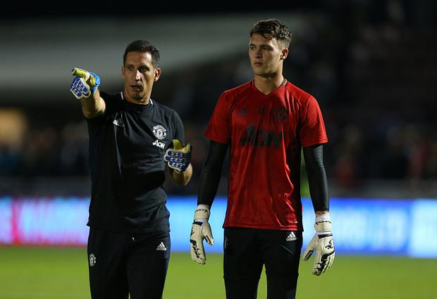 Goalkeeping coach Emilio Alvarez and Manchester United's Kieran O'Hara. Photo: Catherine Ivill - AMA/Getty Images