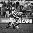 Liam Brady tackles Ian Rush during Ireland's friendly against Wales in 1986. Photo: Getty