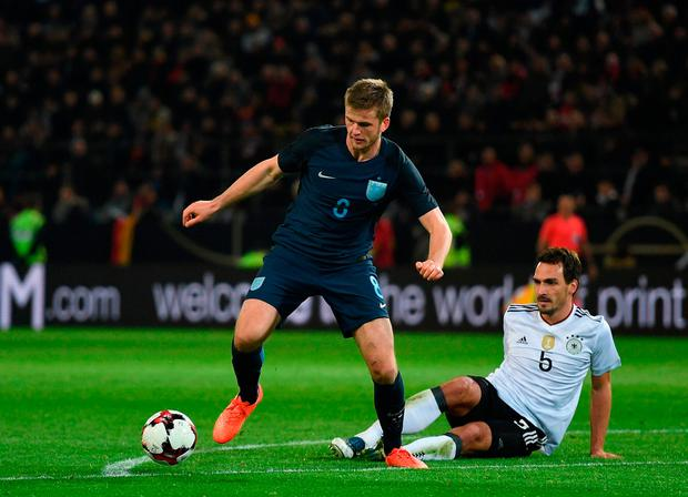 Eric Dier of England (L) escapes a challenge from Mats Hummels of Germany. Photo: Shaun Botterill/Getty Images