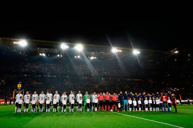 The Germany and England teams line up prior to the international friendly. Photo: Lars Baron/Bongarts/Getty Images