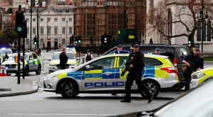 Armed police respond outside Parliament. Photo: Reuters