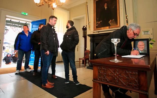 Members of the public sign the book of condolences for Martin McGuinness at the Mansion House in Dublin. Photo: Collins