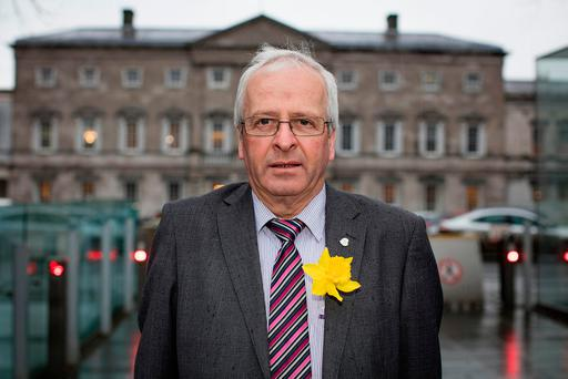 TD Mattie McGrath wearing his daffodil outside the Dáil. Photo: Arthur Carron