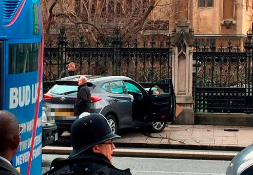 The car driven by the attacker is seen crashed by the Palace of Westminster. Photo: PA