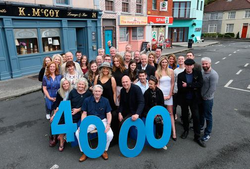 The cast of RTÉ's 'Fair City' gather on the set in 'Carrigstown' to celebrate the 4,000th episode of the soap last year. Photo: Colin Keegan