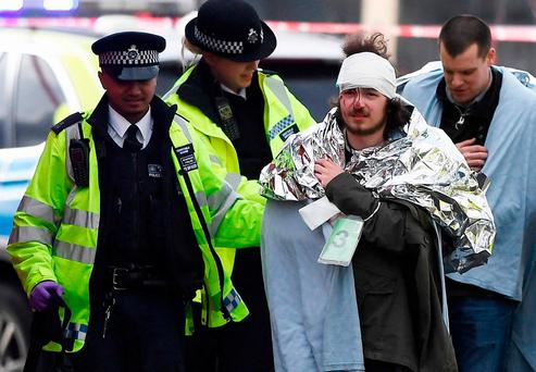 A member of the public is treated by emergency services near Westminster Bridge. Photo: GETTY