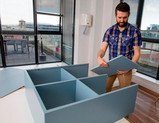 Gavin shows how easy it is to put together IKEA's new flatpack system. Pictures: Arthur Carron