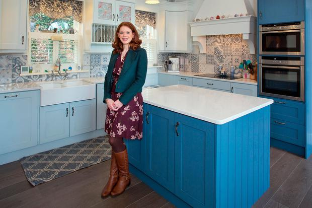 Kimberley in the mosaic tiled kitchen. Photo: Tony Gavin